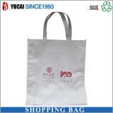 白の印刷されるロゴの非編まれたショッピング・バッグ