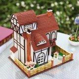 Casa de muñeca de madera con los juguetes educativos para los cabritos