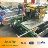Macchina del lastricatore (con il generatore riparato) per la pista corrente atletica, pista di plastica