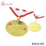 El diseño de Canadá la medalla de color oro