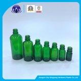 Botella de vidrio de color verde Botella de cosméticos para el aceite esencial con gotero