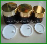 Kosmetische Glasflasche mit weißen inneren Kappen und schwarzen Kappen