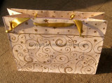 Хозяйственная сумка бумаги конструкции звезды золота