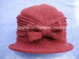 冬の帽子の女性のための弓が付いている方法によって編まれるウールの帽子