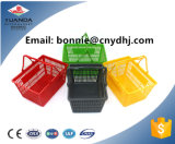 Cesta plástica nova do punho da cesta de compra do supermercado