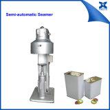Il piccolo metallo semi automatico del quadrato dell'olio di oliva può macchina di sigillamento