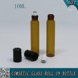 rolo 10ml de vidro ambarino no frasco com o rolo do tampão plástico preto e do aço inoxidável