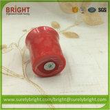 El color rojo superventas mira al trasluz votivo con el olor de Apple