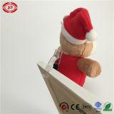 Urso do presente dos miúdos do feriado da peluche do Xmas com o brinquedo funcional do grampo
