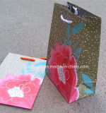 La calidad modifica el bolso promocional del regalo para requisitos particulares de la bolsa de papel de arte de la impresión de la Navidad