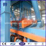 Passaggio del trasportatore a rulli Q69 tramite la macchina di granigliatura
