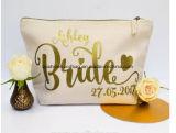 Bolso natural de encargo del maquillaje de la cremallera de la manera del color con el bolso lindo del cosmético de la lona de la belleza del favor de la boda de la insignia del sello de la hoja de oro