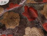 Flores rojas y amarillas en el sofá de tela jacquard fino