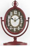 Старинные декоративные предметы антиквариата красного металла в таблице верхней мантии часы