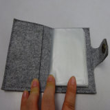 Vestuário de feltro cinza pequeno livro de Telefone