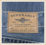 Escritura de la etiqueta de cuero de encargo material genuina y de la PU grabada insignia para la ropa