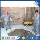 Parete che intonaca la macchina della costruzione del mortaio del cemento dello spruzzatore e della macchina