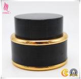 金ボーダーが付いている無光沢の黒く装飾的なクリーム色の瓶