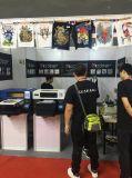 주문 의복은 기계를 인쇄하는 t-셔츠를 주문을 받아서 만든다