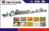 Alimento industrial de la miga de las migas de pan que hace la máquina