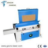 Piccola mini tagliatrice dell'incisione del laser del CO2 60W di 400*600mm con l'asse rotativo