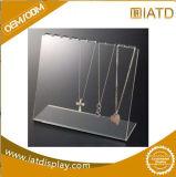 Étalage cosmétique au détail en plastique de bijou de lunetterie acrylique claire de mémoire avec des blocages