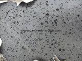 طبيعيّ حمّم بركانيّة حجارة بازلت مع فتحة بئر كبيرة لأنّ أرضيّة راصف