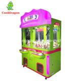 La nuova gru della bambola di divertimento della macchina della gru del giocattolo della peluche lavora il distributore automatico alla macchina dei giocattoli