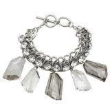 A corrente de ligação Titanium dobro com faceta transparente irregular encanta o bracelete