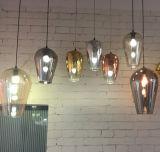 A iluminação de vidro a mais quente do pendente da lâmpada moderna do pendente para o projeto