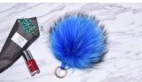 La mode de fourrure de raton-laveur de chaîne de clé de POM Pompom de fourrure véritable le raton laveur
