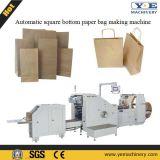 機械を作る正方形の最下の紙袋を入れる自動ロール