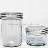 アルミニウムふたが付いている別のサイズの円形のガラス瓶