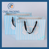 Blaues Geschenk-Papierbeutel mit Drucken