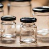 標準的な六角形のガラス込み合いの瓶の込み合いの蜂蜜の瓶の工場