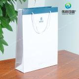 Kundenspezifischer preiswerterer Druckpapier-verpackengeschenk-Beutel mit Seilen