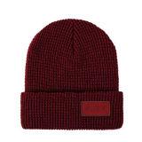 Шлем Beanie Knit горячего сбывания дешевый с кожаный логосом заплаты