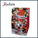 美しく小さい犬の光沢のある表面の仕上げの休日デザイン紙袋