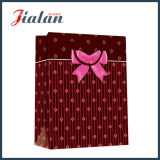 光沢のあるラミネーションの黒のロゴはクリスマスによって印刷される紙袋をカスタマイズする
