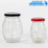 Vaso di vetro dell'ostruzione del muratore del vaso all'ingrosso del miele con il coperchio del metallo