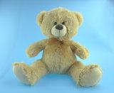 Ours brun clair de jouet de peluche de gosses avec la bande