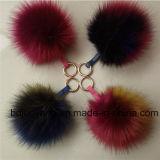 Le Pompom de fourrure de Faux de trousseau de clés de la fourrure POM a assorti les Pompoms colorés