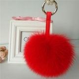 Pelliccia POM di Keychain del cuoio di fascino del sacchetto di modo dell'anello portachiavi della sfera della pelliccia