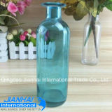 Цветастая стеклянная бутылка для расположения цветка