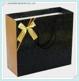 A qualidade assegurou o saco de compra de papel luxuoso do punho feito sob encomenda da fita do preto do logotipo