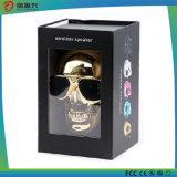 Altavoz Bluetooth inalámbrico metálico de cráneo dorado