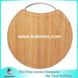 Scheda di taglio di bambù rotonda con la maniglia dell'acciaio inossidabile