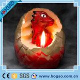 Candela calda dell'uovo di dinosauro che cova la candela creativa della candela del dinosauro