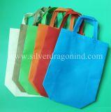 Sacs de transporteur non-tissés de vente chaude, sac à provisions de T-shirt, respectueux de l'environnement