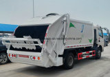 Sinotrukトラック5トンのコンパクターのごみ収集車HOWO 5 CBMの屑輸送の